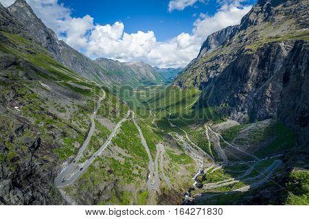 Famous Road of Trolls mountain serpentine in deep canyon landscape. Trollstigen, Norway.