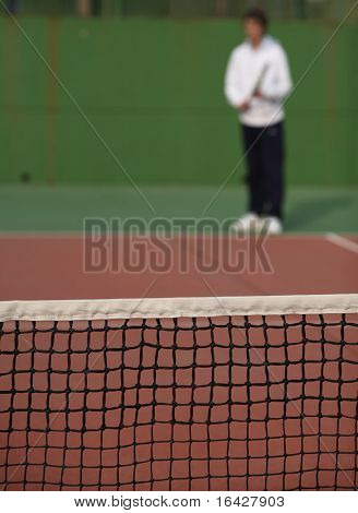 Tennis player waiting for the serve of his
