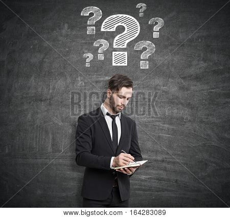 Pensive Man Near Question Mark