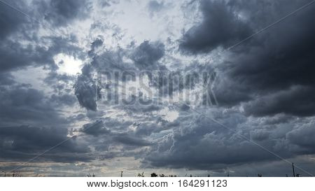 Very beautiful dark clouds slowly flying in the sky