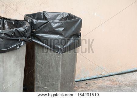 black garbage bag plastic wear in trashcan