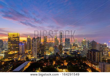 Top view of Bangkok modern office buildings condominium in Bangkok city downtown with sunset sky Bangkok is the most populated city in Southeast Asia. Bangkok Thailand