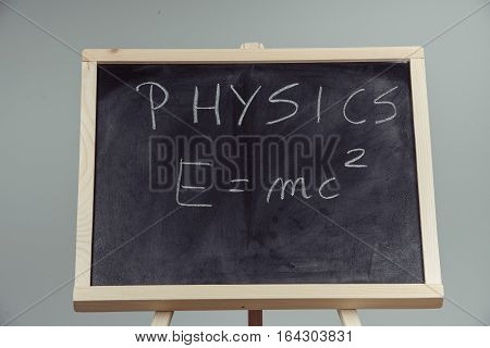 poster of Physics Word And Formula E=mc2 On Chalkboard