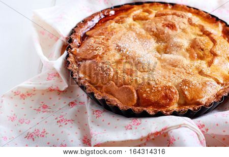 Pie with sugar crust topping in a tin