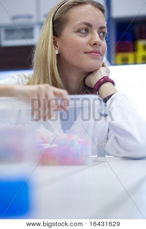 pretty researcher in a lab - daydreaming