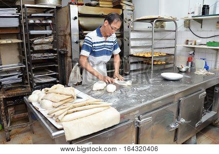 Chef Forming Dough In Order To Prepare Bread