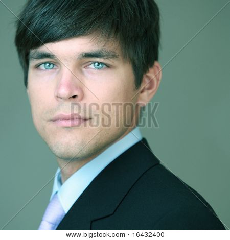 Portrait of a young handsome confident businessman (color toned image)