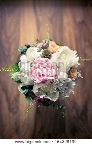 Beautiful delicate bridal bouquet. Top view. Floral wedding theme.