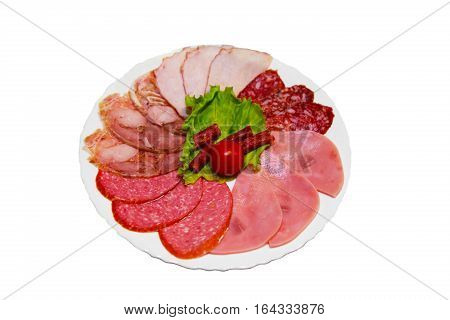 Sliced cold meat and sausage stacked on a plate. The appetizer of pork on a platter. Served with ham dish. Food isolated on white.