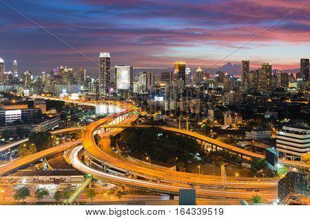 Dramatic sky after sunset over Bangkok city downtown and highway intersection long exposure Bangkok Thailand