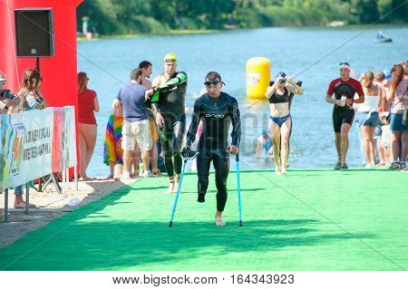 Triathlon Cup of Ukraine and Cup of Bila Tserkva. July 24 2016 in Bila Tserkva Ukraine. Paralympic athlete disabled man running with crutch