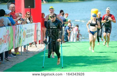 Triathlon Cup of Ukraine and Cup of Bila Tserkva. July 24 2016 in Bila Tserkva Ukraine. Paralympic athlete disabled man after swimming on race