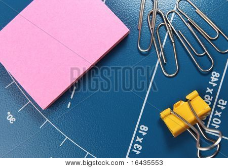 office stationery - paper clips and post-it pink note paper