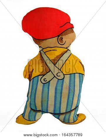 Antique rag doll boy isolated on a white background back view