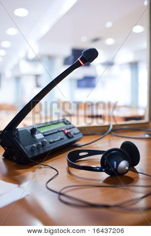 interpreting - Microphone and switchboard in an simultaneous interpreter booth