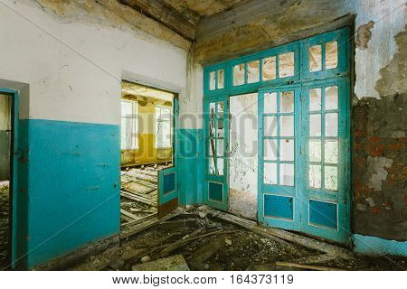 The Ruined Interior Of Abandoned School After Chernobyl Nuclear Disaster In Evacuation Zone. Consequences Of The Radioactive Pollution.