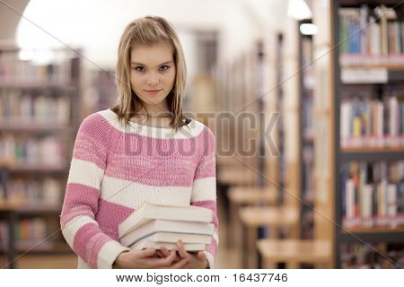 pretty female college student in a library (color toned image)