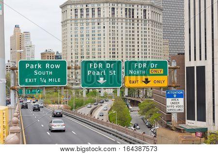 NEW YORK - APRIL 29 2016: Road signs above brooklyn bridge entering manhattan east side