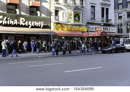 New York New York USA - December 18 2010: Line of diners waiting to enter Carnegie Deli which closed at the end of 2016