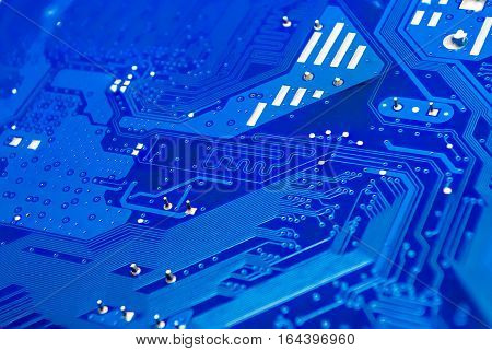 Closeup to Differential Pair on Blue Computer Printed Circuit Board [Soft Focus]
