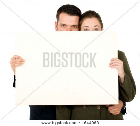 Business Parners Holding A White Card Board