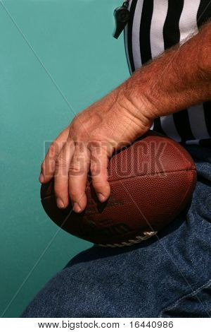 football referee holding ball