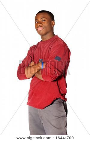 Teenage boy standing with his arms crossed
