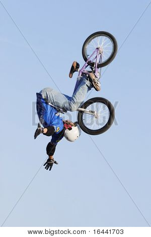 BMX bike rider performing in the Giant Bicycle Stunt Team Show