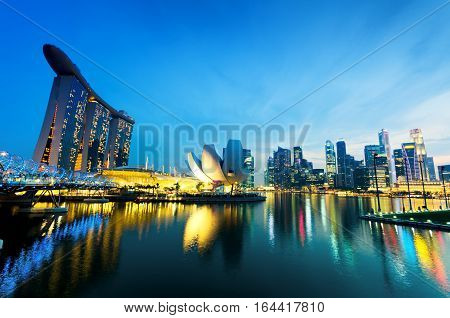 SINGAPORE - APRIL 7: View of Marina Bay on April 7, 2011 in Singapore. Night Scene. Marina Bay is famous destination in Singapore.