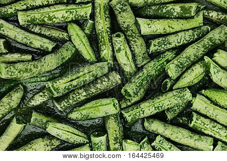 Fresh frozen green french bean with hoarfrost closeup as background. Healthy vitamin food.