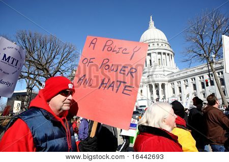 MADISON, WI-FEB 19: Opponents march in protest of Gov Scott Walker's bill to take away the bargaining rights of public workers on February 19, 2011 in Madison, Wisconsin.