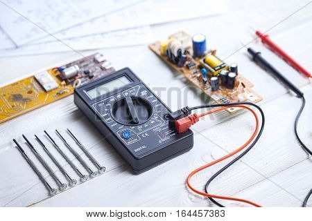 close up of Electronic technician measure electricity