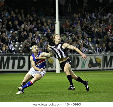 Western Bulldog Jason Akermanis and Collingwood's Ben Johnson compete for a mark in June 2008.