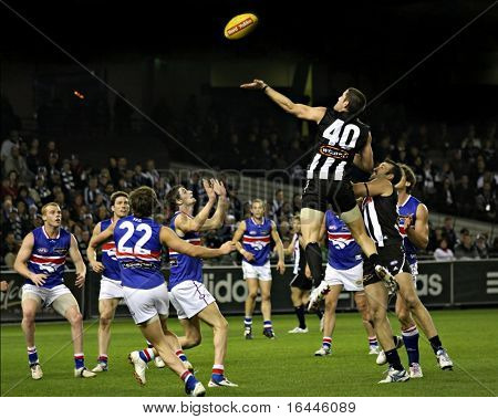 Collingwood's Chris Bryan taps the ball to Scott Burns for a goal agains the Western Bulldogs, June 2008