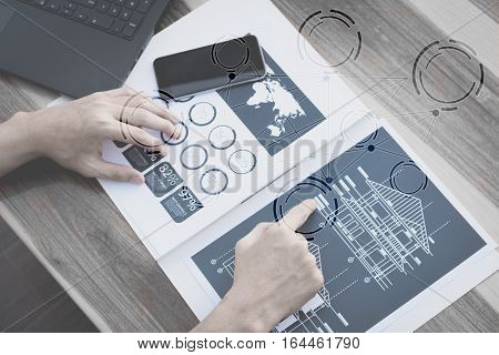 business technology conceptBusiness people hands use smart phone and laptop for business analyst project on table with blank icon symbolselective focus.