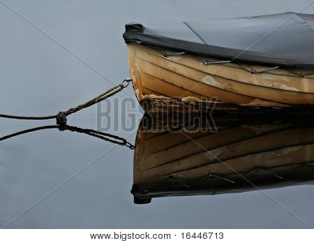 Old rowboat moored in a peaceful bay - Strahan, Tasmania