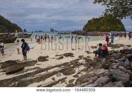 KRABI THAILAND : APRIL 16 : large number of tourist walking on koh kai island most famous andaman sea traveling destination in krabi southern of thailand on april 16 2013