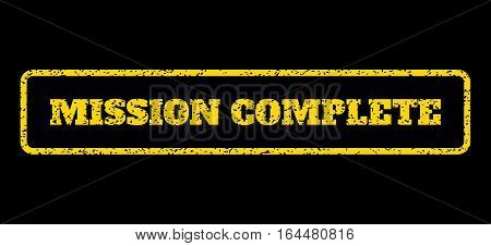 Yellow rubber seal stamp with Mission Complete text. Vector message inside rounded rectangular frame. Grunge design and dirty texture for watermark labels. Horisontal sign on a blue background.
