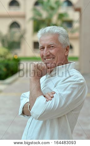 Portrait of a handsome mature man, smiling and posing