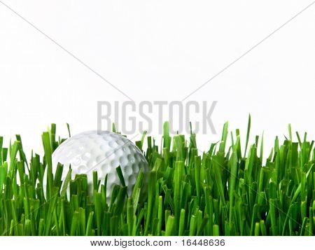 Golf ball in grass isolated on white background