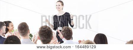 Energetic team leader having a briefing with her team