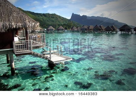 Overwater bungalows at resort in Moorea, French Polynesia