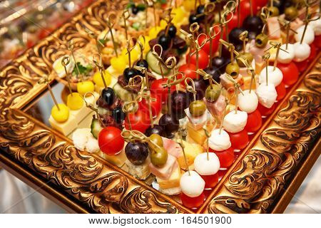 outbound event catering - canapes, snacks on a mirrored tray: ham, pear and aged parmesan cheese