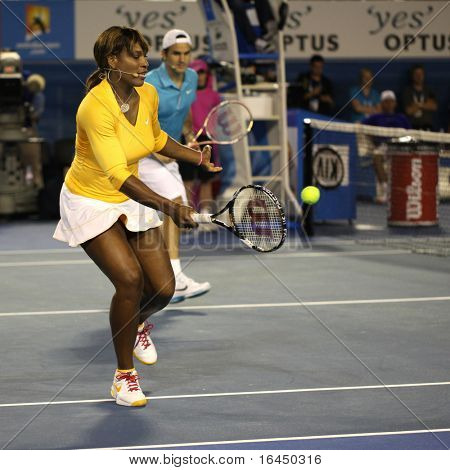 MELBOURNE, AUSTRALIA - JANUARY 17: Serena Williams and Roger Federer during a charity tennis exhibition  for the victims of the Haiti earthquake on January 17, 2010 in Melbourne.