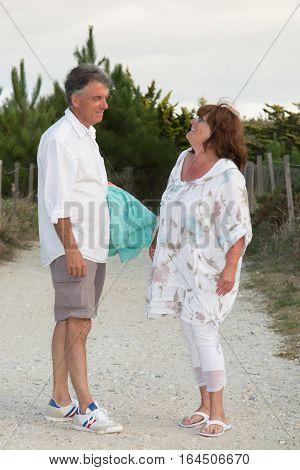 Couple Of Retired Seniors Enjoys Retirement By Strolling