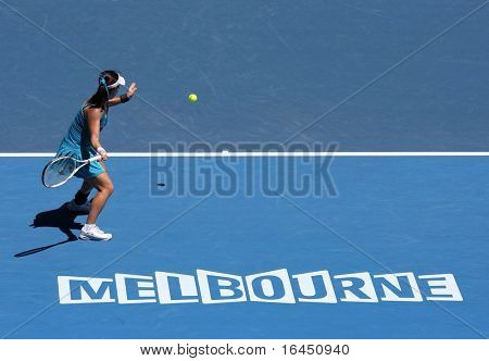 MELBOURNE, AUSTRALIA - JANUARY 26: Jie Zheng in her quarter final win over Maria Kirilenko  during the 2010 Australian Open on January 26, 2010 in Melbourne, Australia