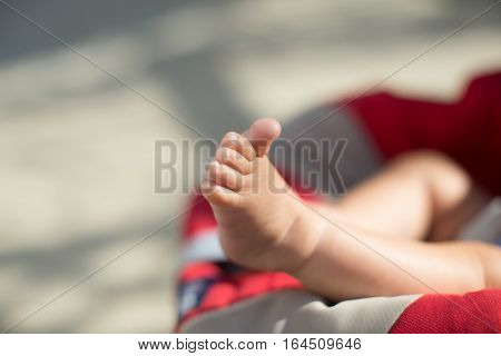 Newborn Baby Feet Sitting In Carriage Or Buggy