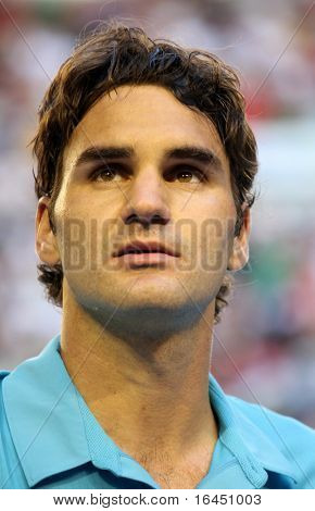 MELBOURNE - JANUARY 27: Roger Federer looks on after his win over Nikolay Davydenko during a quarter final match in the 2010 Australian Open on January 27, 2010 in Melbourne