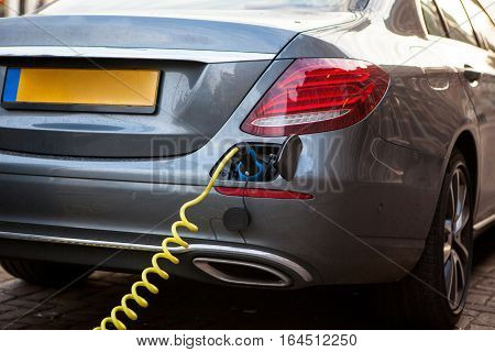 the power supply plugged into an electric car being charged.