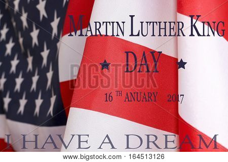 Martin Luther King Day background. The text of Martin Luther King Day 16 January 2017 and the US flag.